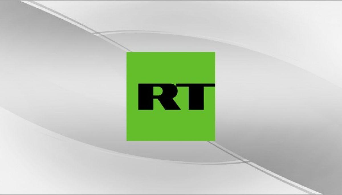 Пропагандисти RT відфотошопили світлину Reuters, домалювавши зброю біженцям з Афганістану